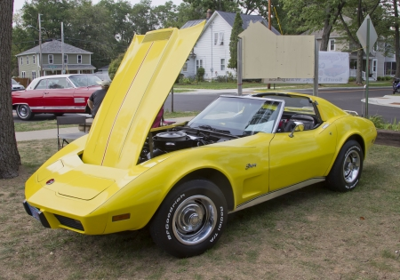 WAUPACA, WI - AUGUST 25: Side view of a yellow 1975 Corvette Stingray classic car at the 10th Annual Waupaca Rod & Classic Car Club Car Show on August 25, 2012 in Waupaca, Wisconsin. Stock Photo - 14985860