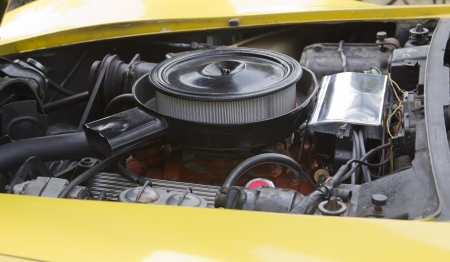 WAUPACA, WI - AUGUST 25: Engine of a yellow 1975 Corvette Stingray classic car at the 10th Annual Waupaca Rod & Classic Car Club Car Show on August 25, 2012 in Waupaca, Wisconsin. Stock Photo - 14985850