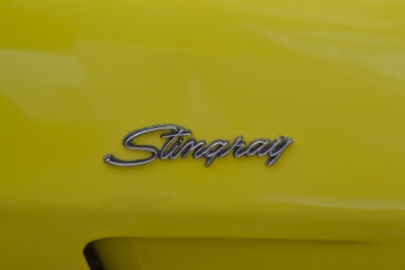 WAUPACA, WI - AUGUST 25: Side name of a yellow 1975 Corvette Stingray classic car at the 10th Annual Waupaca Rod & Classic Car Club Car Show on August 25, 2012 in Waupaca, Wisconsin.