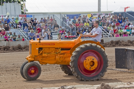 DE PERE, WI - AUGUST 18: A vintage Minneapolis Moline ZB orange & red Tractor competing at the Tractor Pull event at the Brown County Fair on August 18, 2012 in De Pere, Wisconsin.