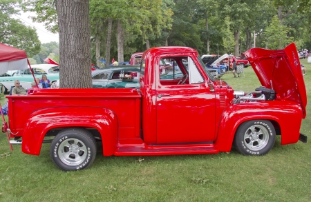 waupaca: WAUPACA, WI - AUGUST 25: Red 1955 Ford F-100 Pickup Truck at the 10th Annual Waupaca Rod & Classic Car Club Car Show on August 25, 2012 in Waupaca, Wisconsin.