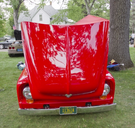 WAUPACA, WI - AUGUST 25: Front view of a red 1955 Ford F-100 Pickup Truck at the 10th Annual Waupaca Rod & Classic Car Club Car Show on August 25, 2012 in Waupaca, Wisconsin.