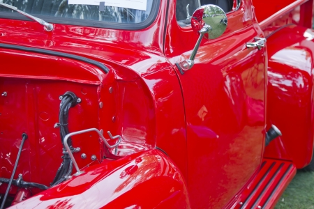 WAUPACA, WI - AUGUST 25: Side panel of a red 1955 Ford F-100 Pickup Truck at the 10th Annual Waupaca Rod & Classic Car Club Car Show on August 25, 2012 in Waupaca, Wisconsin.