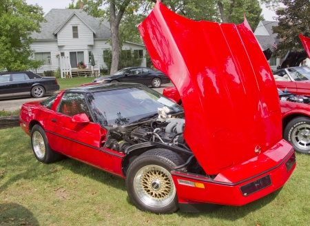 WAUPACA, WI - AUGUST 25: Red 1986 Chevy Corvette car at the 10th Annual Waupaca Rod & Classic Car Club Car Show on August 25, 2012 in Waupaca, Wisconsin. Editorial