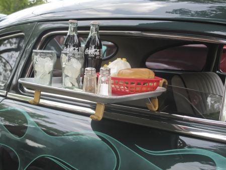WAUPACA, WI - AUGUST 25: Drive thu tray on 1949 Mercury Coupe car with burger, coca cola, and fries at the 10th Annual Waupaca Rod & Classic Car Club Car Show on August 25, 2012 in Waupaca, Wisconsin.