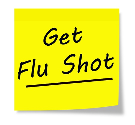 flu shot: Get Flu Shot written on a yellow square sticky note pad.