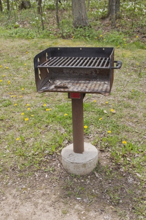 BBQ Grill at Park on a metal and concrete stand.