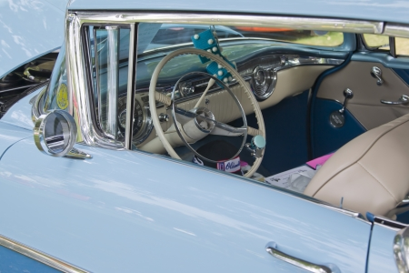 olds: WAUPACA, WI - AUGUST 25: Interior of 1955 Olds 88 Oldsmobile car at the 10th Annual Waupaca Rod & Classic Car Club Car Show on August 25, 2012 in Waupaca, Wisconsin. Editorial