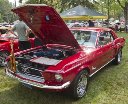 WAUPACA, WI - AUGUST 25: 1968 red Ford Mustang at the 10th Annual Waupaca Rod & Classic Car Club Car Show on August 25, 2012 in Waupaca, Wisconsin.