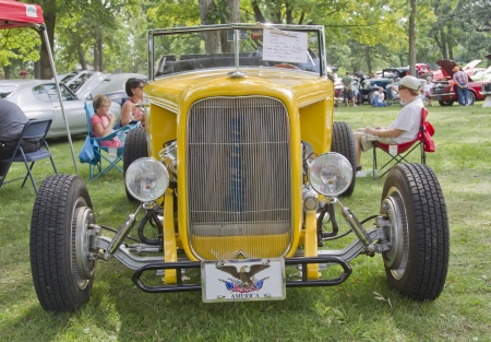 WAUPACA, WI - AUGUST 25: Front view of a 1932 yellow Ford Roadster car at the 10th Annual Waupaca Rod & Classic Car Club Car Show on August 25, 2012 in Waupaca, Wisconsin.