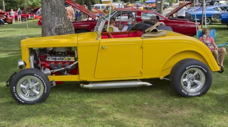 waupaca: WAUPACA, WI - AUGUST 25: Side view of a 1932 yellow Ford Roadster car at the 10th Annual Waupaca Rod & Classic Car Club Car Show on August 25, 2012 in Waupaca, Wisconsin.