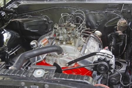 WAUPACA, WI - AUGUST 25: Engine of a 1964 Chevy El Camino car at the 10th Annual Waupaca Rod & Classic Car Club Car Show on August 25, 2012 in Waupaca, Wisconsin. Stock Photo - 15078204