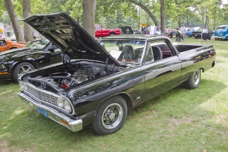 WAUPACA, WI - AUGUST 25: Black 1964 Chevy El Camino car at the 10th Annual Waupaca Rod & Classic Car Club Car Show on August 25, 2012 in Waupaca, Wisconsin. Stock Photo - 15078261