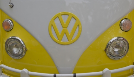 vw: WAUPACA, WI - AUGUST 25:  Close up of Yellow & White 1966 VW Volkswagon Camper van at the 10th Annual Waupaca Rod & Classic Car Club Car Show on August 25, 2012 in Waupaca, Wisconsin. Editorial