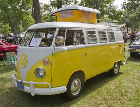 vw: WAUPACA, WI - AUGUST 25:  Side view of Yellow & White 1966 VW Volkswagon Camper van at the 10th Annual Waupaca Rod & Classic Car Club Car Show on August 25, 2012 in Waupaca, Wisconsin.