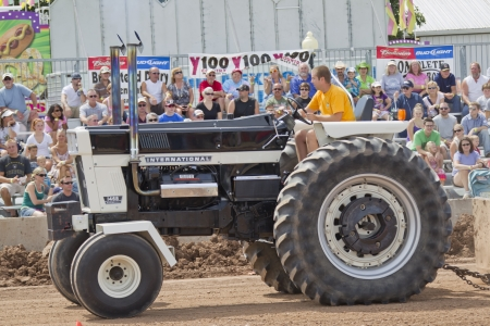 DE PERE, WI - AUGUST 18: An International Tractor The Reverend Mr. Black competing at the Tractor Pull event at the Brown County Fair on August 18, 2012 in De Pere, Wisconsin.