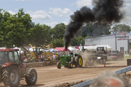 deere: DE PERE, WI - AUGUST 18: John Deere 6030 Tractor competing at the Tractor Pull event at the Brown County Fair on August 18, 2012 in De Pere, Wisconsin.