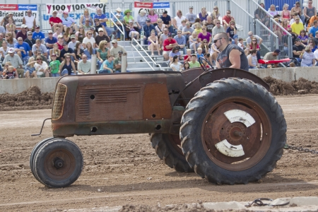 DE PERE, WI - AUGUST 18: An Old rusted Tractor competing at the Tractor Pull event at the Brown County Fair on August 18, 2012 in De Pere, Wisconsin.