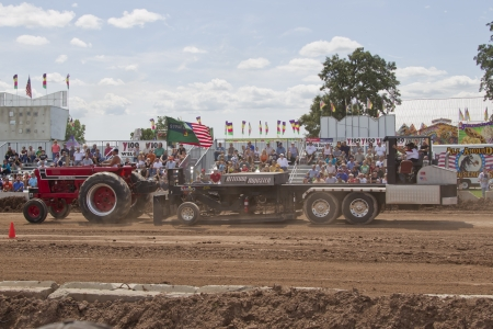 DE PERE, WI - AUGUST 18: Red International 966 Tractor with the Attitude Adjuster at the Tractor Pull event at the Brown County Fair on August 18, 2012 in De Pere, Wisconsin.
