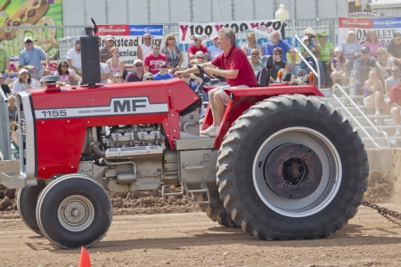 DE PERE, WI - AUGUST 18: Close up of Red Massey Ferguson 1155 Tractor competing at the Tractor Pull event at the Brown County Fair on August 18, 2012 in De Pere, Wisconsin.