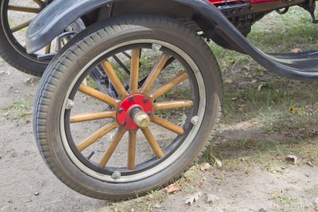 WAUPACA, WI - AUGUST 25: Wooden wheel of a rare 1926 Ford Model T red car at the 10th Annual Waupaca Rod & Classic Car Club Car Show on August 25, 2012 in Waupaca, Wisconsin. Editorial