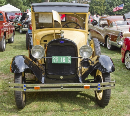WAUPACA, WI - AUGUST 25: Front view of 1929 yellow Ford Model A car at the 10th Annual Waupaca Rod & Classic Car Club Car Show on August 25, 2012 in Waupaca, Wisconsin. Editorial