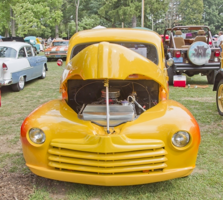 WAUPACA, WI - AUGUST 25: Front view of 1948 yellow Ford yellow Pickup truck at the 10th Annual Waupaca Rod & Classic Car Club Car Show on August 25, 2012 in Waupaca, Wisconsin. Editorial