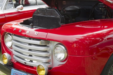 WAUPACA, WI - AUGUST 25: Grill of 1950 Ford F1 red Pickup truck at the 10th Annual Waupaca Rod & Classic Car Club Car Show on August 25, 2012 in Waupaca, Wisconsin.