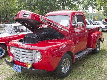 WAUPACA, WI - AUGUST 25: 1950 Ford F1 red Pickup truck at the 10th Annual Waupaca Rod & Classic Car Club Car Show on August 25, 2012 in Waupaca, Wisconsin. Editorial