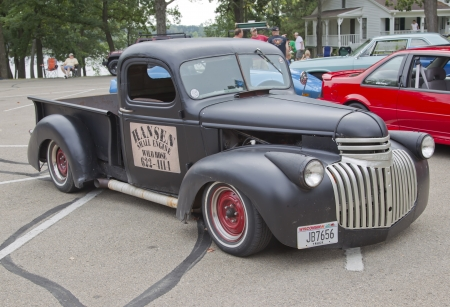 WAUPACA, WI - AUGUST 25:  Old black Chevy Pickup Truck at the 10th Annual Waupaca Rod & Classic Car Club Car Show on August 25, 2012 in Waupaca, Wisconsin. Stock Photo - 15102193