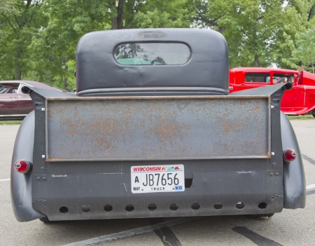 WAUPACA, WI - AUGUST 25: Back of old black Chevy Pickup Truck at the 10th Annual Waupaca Rod & Classic Car Club Car Show on August 25, 2012 in Waupaca, Wisconsin. Stock Photo - 15102182