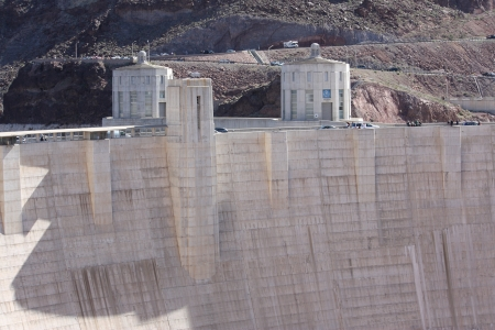 BOULDER CITY, NV - MARCH 4: A crowd watches on top of Hoover Dam to look at the construction of the Mike O'Callaghan - Pat Tillman Memorial Bridge highway bypass as it nears completion on March 4, 2010 in Boulder City, Nevada. Stock Photo - 15102186