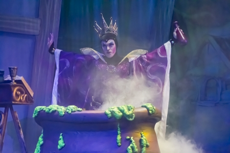 GREEN BAY, WI - FEBRUARY 10: Wicked Witch casting a spell into Cauldron in Snow White at the Disney Princesses show at the Resch Center on February 10, 2012 in Green Bay, Wisconsin.