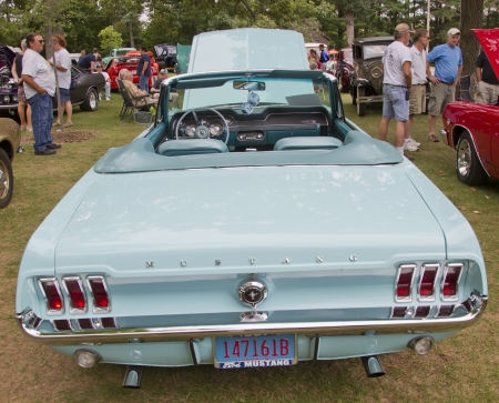 waupaca: WAUPACA, WI - AUGUST 25: Rear of 1967 Aqua Blue Ford Mustang car at the 10th Annual Waupaca Rod & Classic Car Club Car Show on August 25, 2012 in Waupaca, Wisconsin.