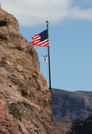 A flag flies in the wind at Hoover Dam. Stock Photo - 15134305