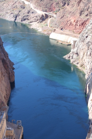 River and Water below Hoover Dam shows running current and low water levels. photo