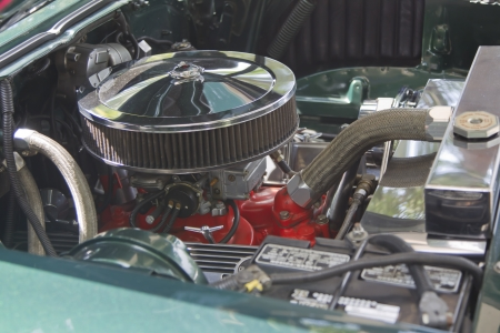 WAUPACA, WI - AUGUST 25: Engine of 1957 Chevy green car at the 10th Annual Waupaca Rod & Classic Car Club Car Show on August 25, 2012 in Waupaca, Wisconsin. Editorial