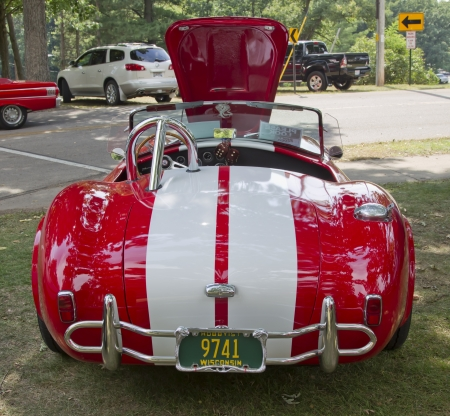 WAUPACA, WI - AUGUST 25: Back of 1965 Red White Ford AC Cobra car at the 10th Annual Waupaca Rod & Classic Car Club Car Show on August 25, 2012 in Waupaca, Wisconsin.