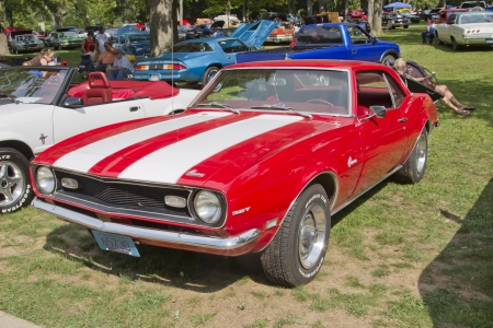 waupaca: WAUPACA, WI - AUGUST 25: Red White Chevy Camaro 327 car at the 10th Annual Waupaca Rod & Classic Car Club Car Show on August 25, 2012 in Waupaca, Wisconsin. Editorial