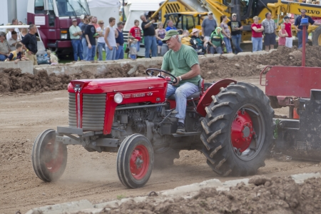 DE PERE, WI - AUGUST 18: Massey Ferguson Tractor competing at the Tractor Pull event at the Brown County Fair on August 18, 2012 in De Pere, Wisconsin.