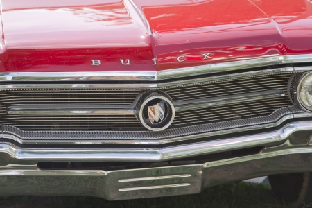 waupaca: WAUPACA, WI - AUGUST 25: Close up of grill & emblem of Vintage Red Buick car at the 10th Annual Waupaca Rod & Classic Car Club Car Show on August 25, 2012 in Waupaca, Wisconsin. Editorial