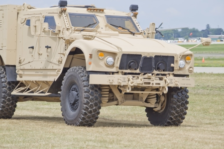 OSHKOSH, WI - JULY 27: A Humvee on parade during Veterans Day events at the 2012 AirVenture at EAA on July 27, 2012 in Oshkosh, Wisconsin.