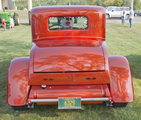 MARION, WI - SEPTEMBER 16: Back of 1930 Orange Chevy Coupe car at the 3rd Annual Not Just Another Car Show on September 16, 2012 in Marion, Wisconsin. Stock Photo - 15318723
