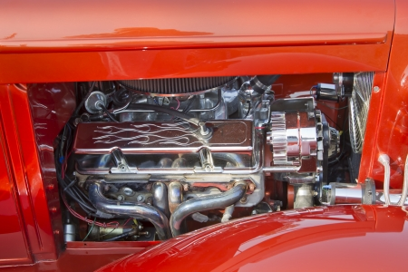 MARION, WI - SEPTEMBER 16: Engine of 1930 Orange Chevy Coupe car at the 3rd Annual Not Just Another Car Show on September 16, 2012 in Marion, Wisconsin. Stock Photo - 15318722