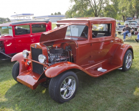 MARION, WI - SEPTEMBER 16: 1930 Orange Chevy Coupe car at the 3rd Annual Not Just Another Car Show on September 16, 2012 in Marion, Wisconsin. Stock Photo - 15318724