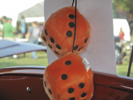 MARION, WI - SEPTEMBER 16: 1930 Orange Dice hanging in Chevy Coupe car at the 3rd Annual Not Just Another Car Show on September 16, 2012 in Marion, Wisconsin. Stock Photo - 15318709