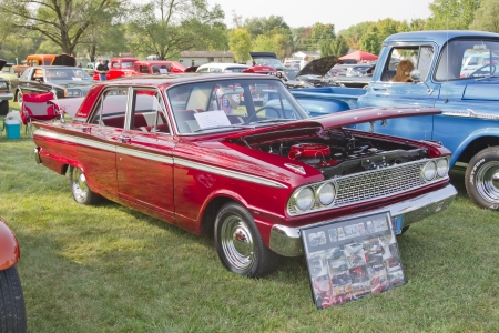 MARION, WI - SEPTEMBER 16: 1963 Red Ford Fairlane car at the 3rd Annual Not Just Another Car Show on September 16, 2012 in Marion, Wisconsin.
