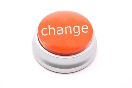 Large red push Change button photographed on a white background Banco de Imagens