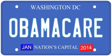An imitation Washington DC license plate with Obamacare written on it and January 2014 stickers.  Words on the bottom Nations Capital.