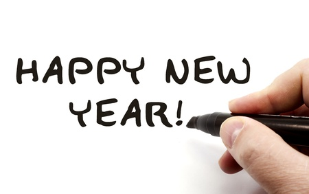 Happy New Year being written with a hand and black felt pen